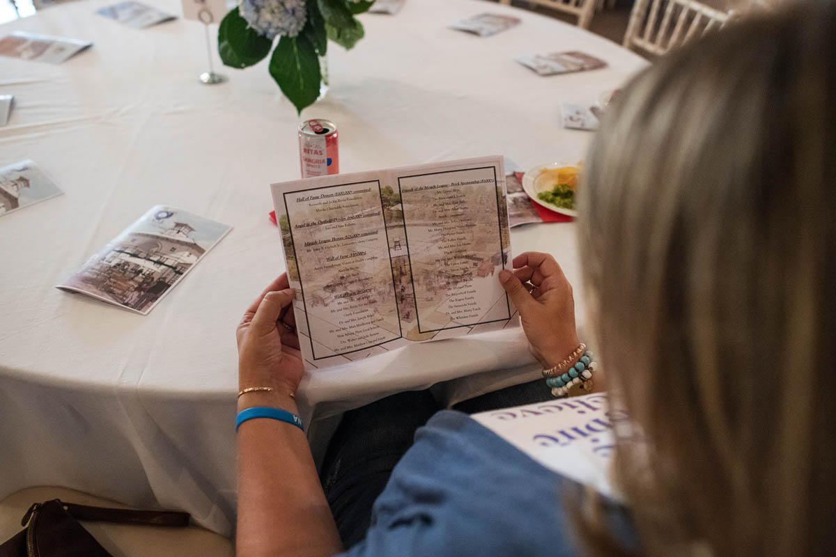 guest looking at event brochure