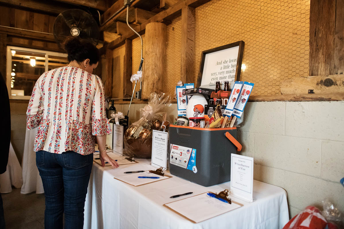 guests at silent auction table