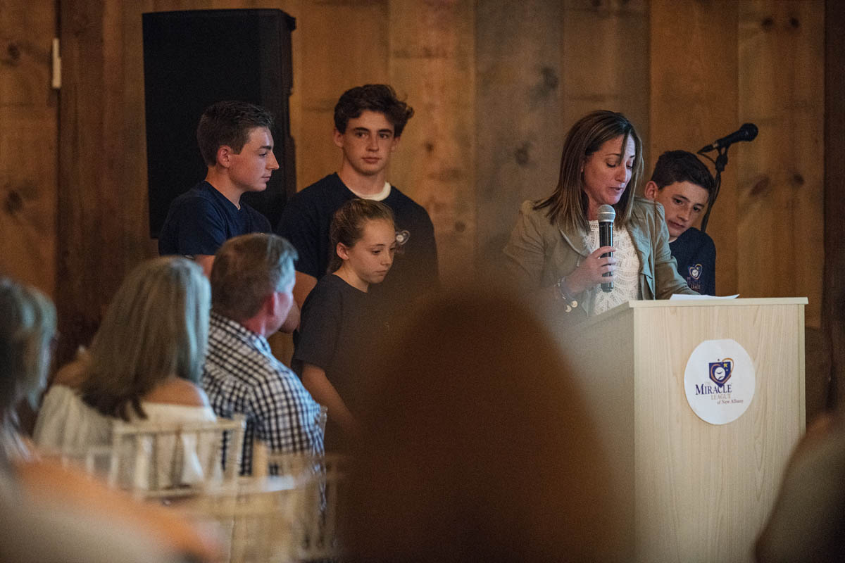 guests and speaker at fundraiser event